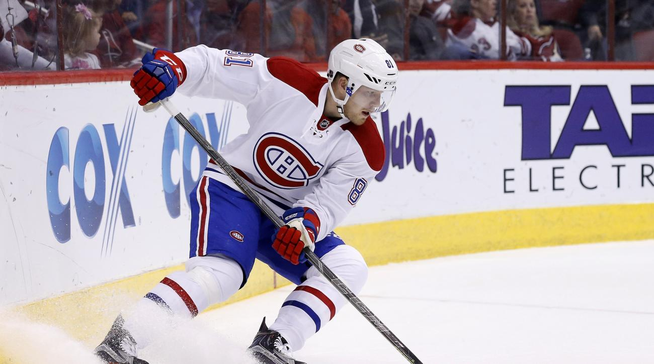 FILE - In this Feb. 15, 2016, file photo, Montreal Canadiens' Lars Eller, of Denmark, skates with the puck against the Arizona Coyotes during the first period of an NHL hockey game in Glendale, Ariz. The Presidents' Trophy-winning Washington Capitals took