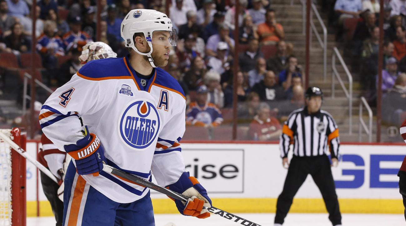 Edmonton Oilers' Taylor Hall looks for the puck during the first period of an NHL hockey game against the Arizona Coyotes Tuesday, March 22, 2016, in Glendale, Ariz.  The Coyotes defeated the Oilers 4-2. (AP Photo/Ross D. Franklin)