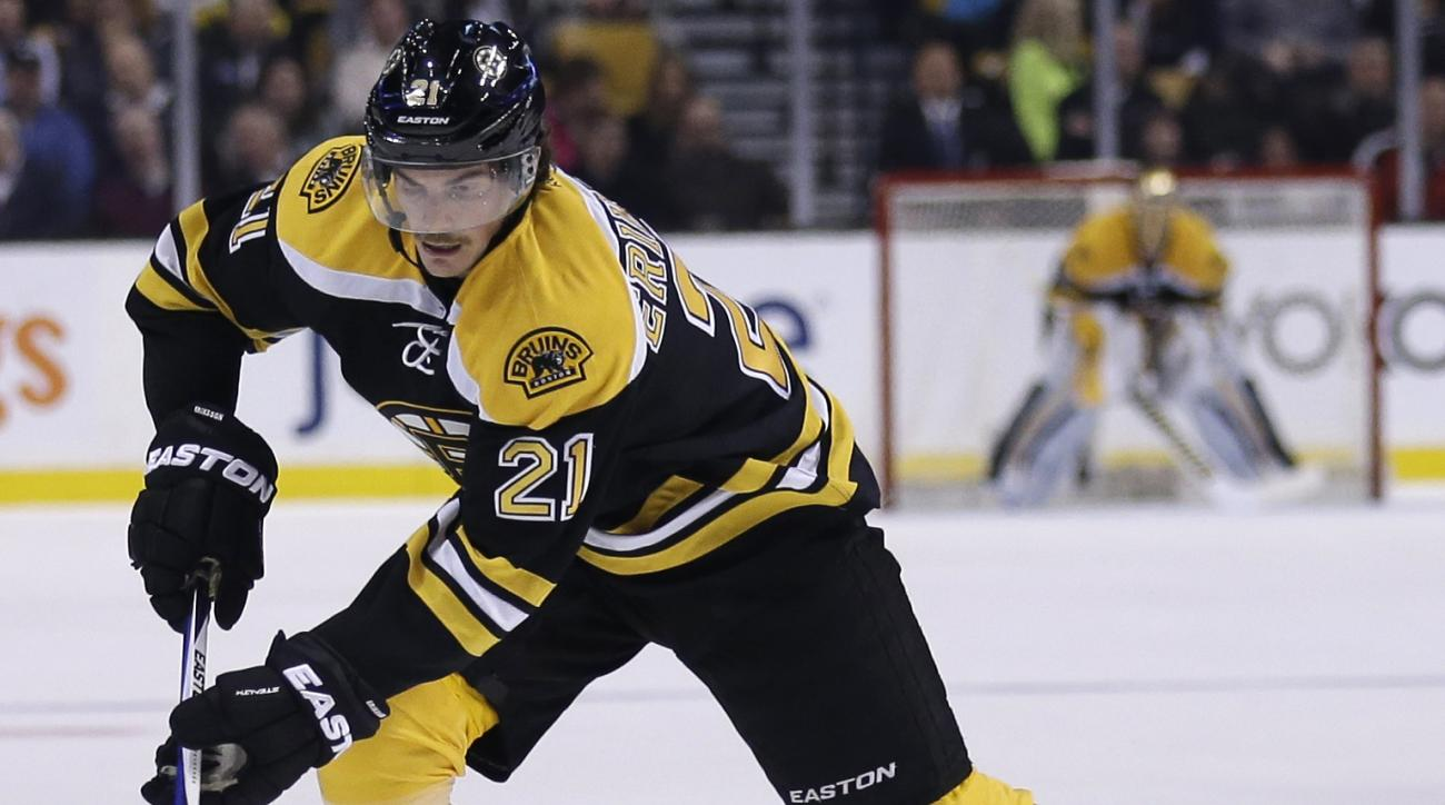 """FILE - In this Nov. 12, 2015, file photo, Boston Bruins left wing Loui Eriksson (21) skates during the second period of an NHL hockey game in Boston. Steven Stamkos isn't the only """"big fish"""" available when NHL free agency opens Friday at noon. The top-tie"""