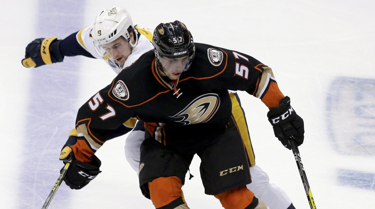 FILE - In this April 27, 2016, file photo, Anaheim Ducks left wing David Perron, right, battles Nashville Predators center Filip Forsberg for the puck during the second period of Game 7 in an NHL hockey Stanley Cup playoffs first-round series in Anaheim,