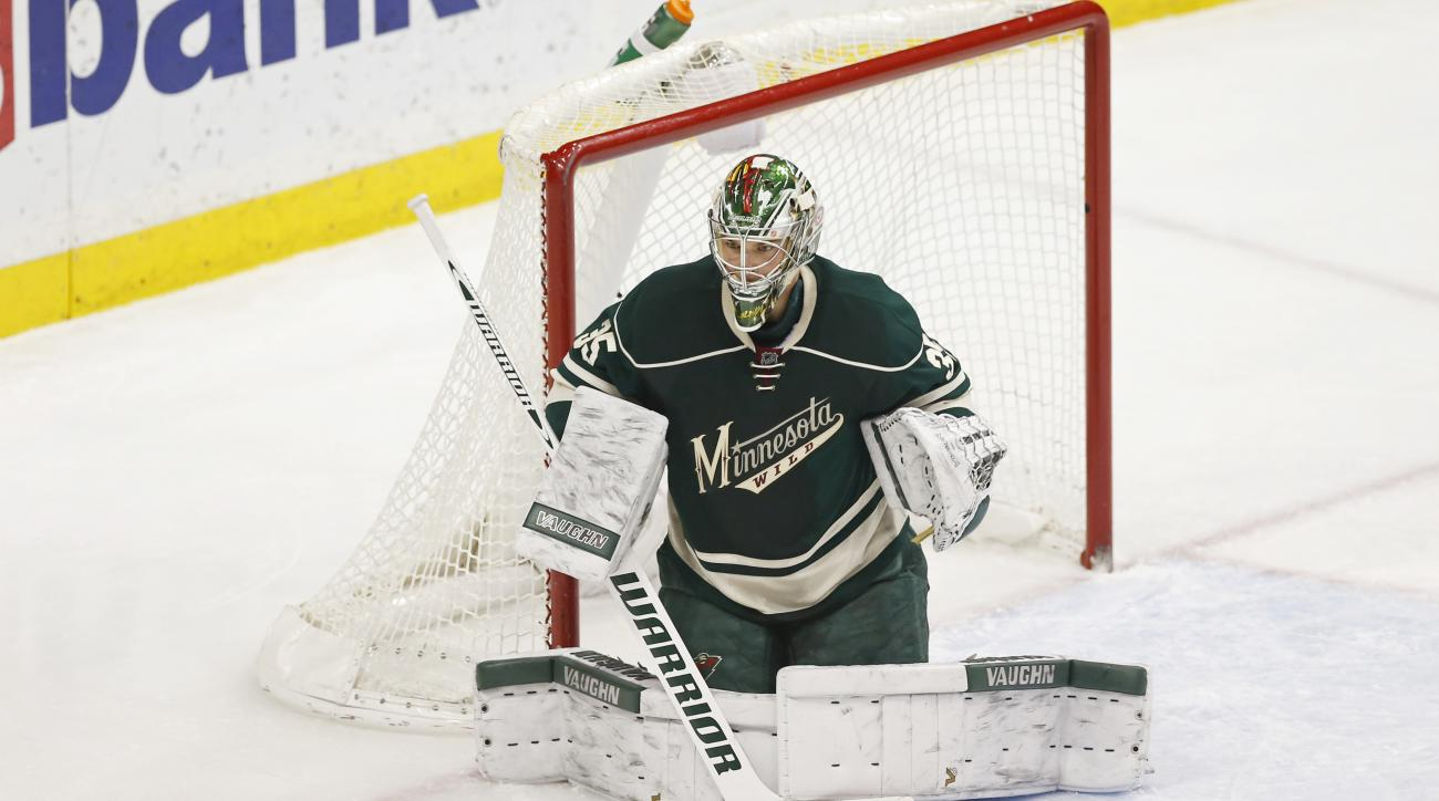 Minnesota Wild goalie Darcy Kuemper defends against the Montreal Canadiens in the first period of an NHL hockey game, Tuesday, Dec. 22, 2015, in St. Paul, Minn. (AP Photo/Jim Mone)