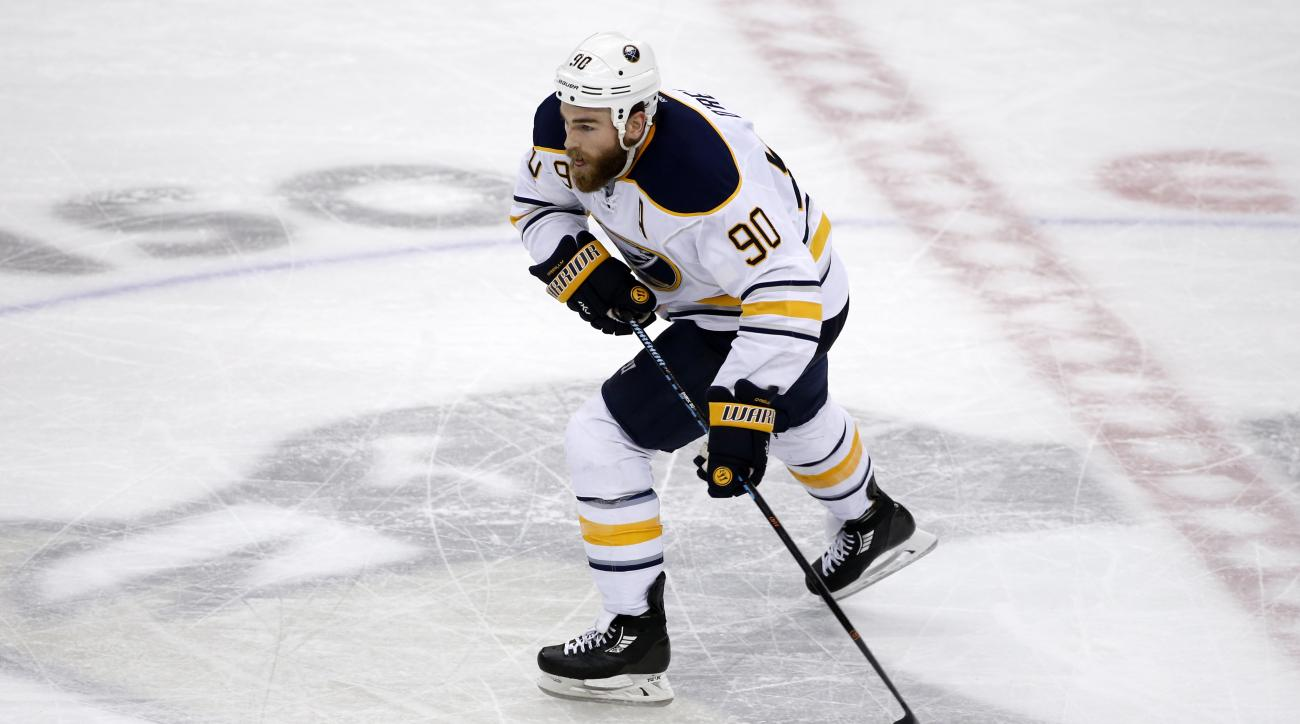 Buffalo Sabres center Ryan O'Reilly (90) plays in an NHL hockey game against the Pittsburgh Penguins in Pittsburgh, Tuesday, March 29, 2016. (AP Photo/Gene J. Puskar)