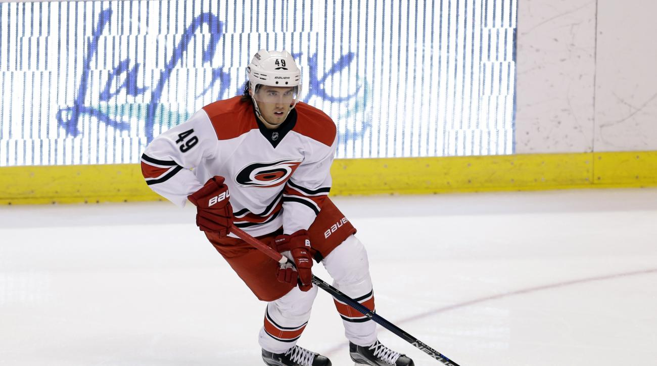 Carolina Hurricanes center Victor Rask (49) skates with the puck during the second period of an NHL hockey game against the Florida Panthers, Saturday, April 9, 2016, in Sunrise, Fla. (AP Photo/Alan Diaz)