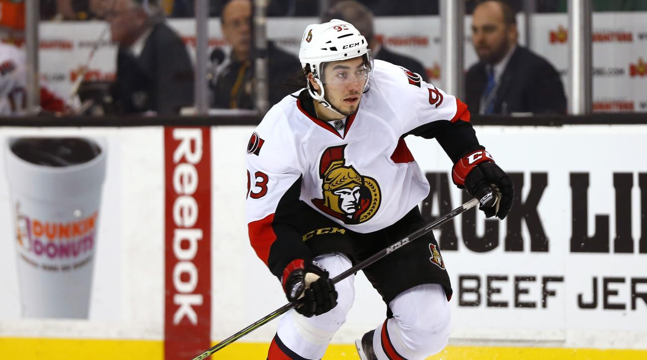 FILE - In this Dec. 13, 2014, file photo, Ottawa Senators center Mika Zibanejad skates during the third period of the Ottawa Senators 3-2 win over the Boston Bruins in a shootout in an NHL hockey game in Boston. The New York Rangers have traded center Der