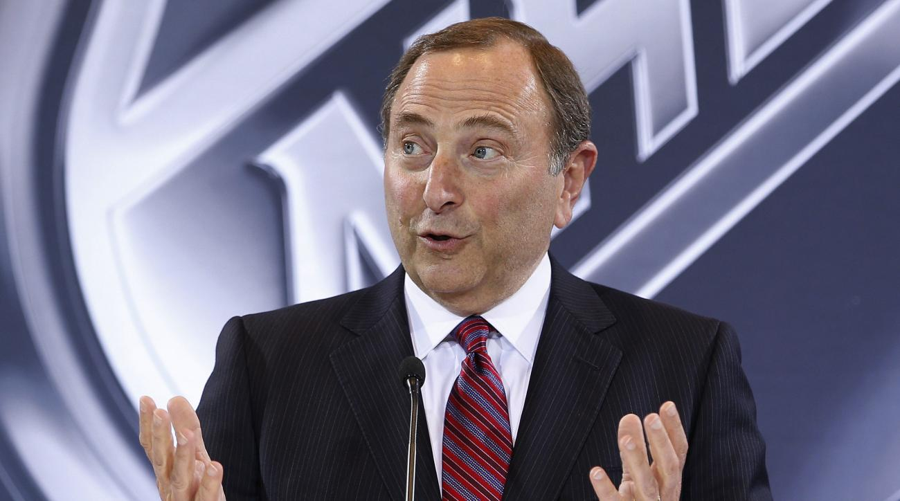 FILE - In this June 22, 2016, file photo, NHL Commissioner Gary Bettman speaks during a news conference in Las Vegas. Bettman's reluctance to link hits to the head in hockey with a degenerative brain disease found in several deceased former players has re