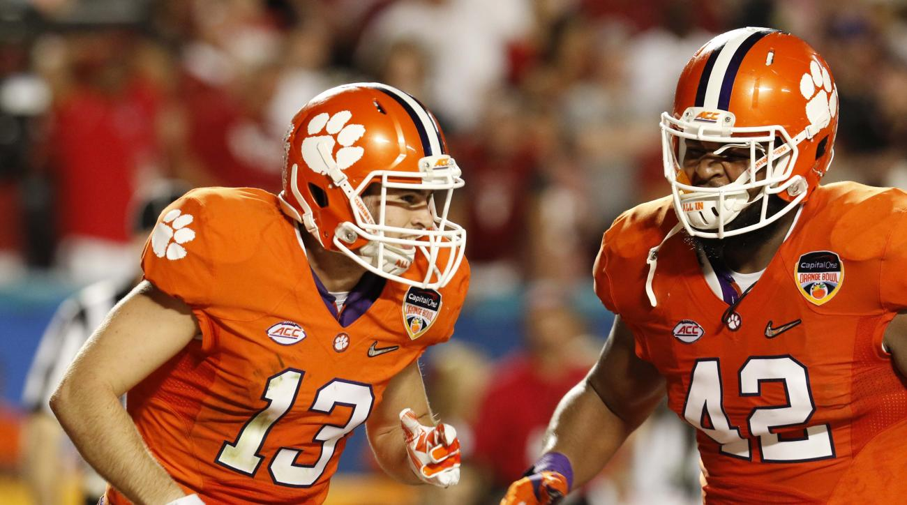 Clemson wide receiver Hunter Renfrow (13) celebrates his touchdown with defensive lineman Christian Wilkins (42) during the second half of the Orange Bowl NCAA college football semifinal playoff game against Oklahoma, Thursday, Dec. 31, 2015, in Miami Gar