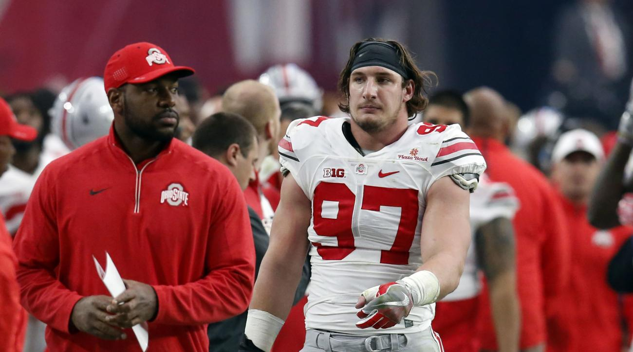 Ohio State defensive lineman Joey Bosa (97) walks off the field after he was ejected for targeting during the first half of the Fiesta Bowl NCAA College football game against Notre Dame, Friday, Jan. 1, 2016, in Glendale, Ariz.  (AP Photo/Rick Scuteri)
