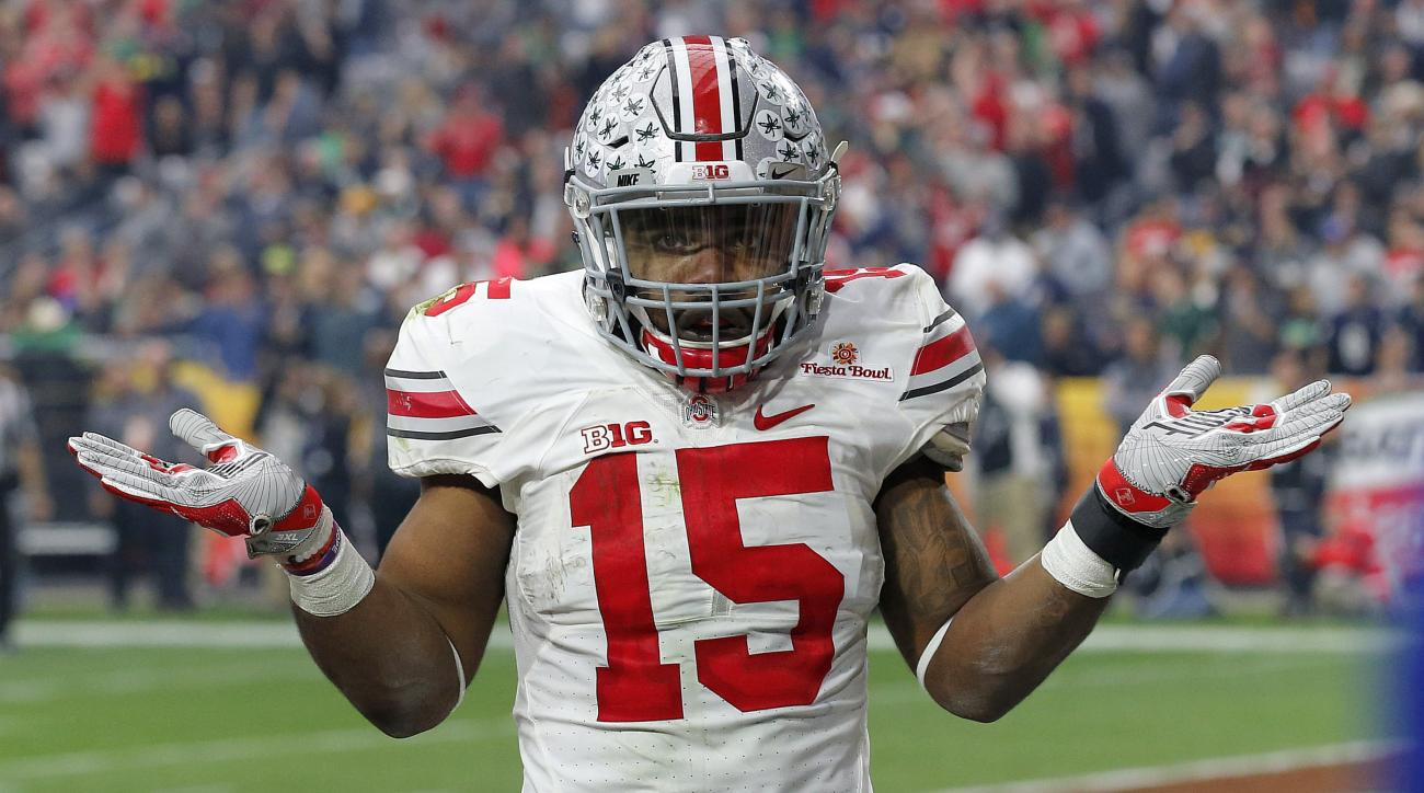 Ohio State running back Ezekiel Elliott (15) gestures as he celebrates his fourth touchdown of the game against Notre Dame  during the second half of the Fiesta Bowl NCAA College football game, Friday, Jan. 1, 2016, in Glendale, Ariz.  (AP Photo/Ross D. F