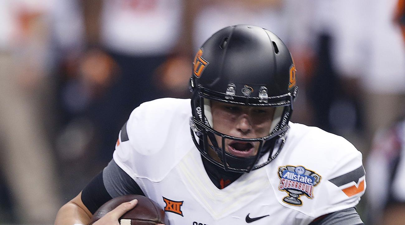 Oklahoma State quarterback Mason Rudolph (2) is sacked by Mississippi defensive tackle D.J. Jones in the first half of the Sugar Bowl college football game in New Orleans, Friday, Jan. 1, 2016. (AP Photo/Bill Feig)