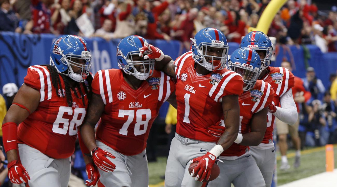 Mississippi wide receiver Laquon Treadwell (1) celebrates his touchdown reception with teammates in the first half of the Sugar Bowl college football game against Oklahoma State in New Orleans, Friday, Jan. 1, 2016. (AP Photo/Bill Feig)