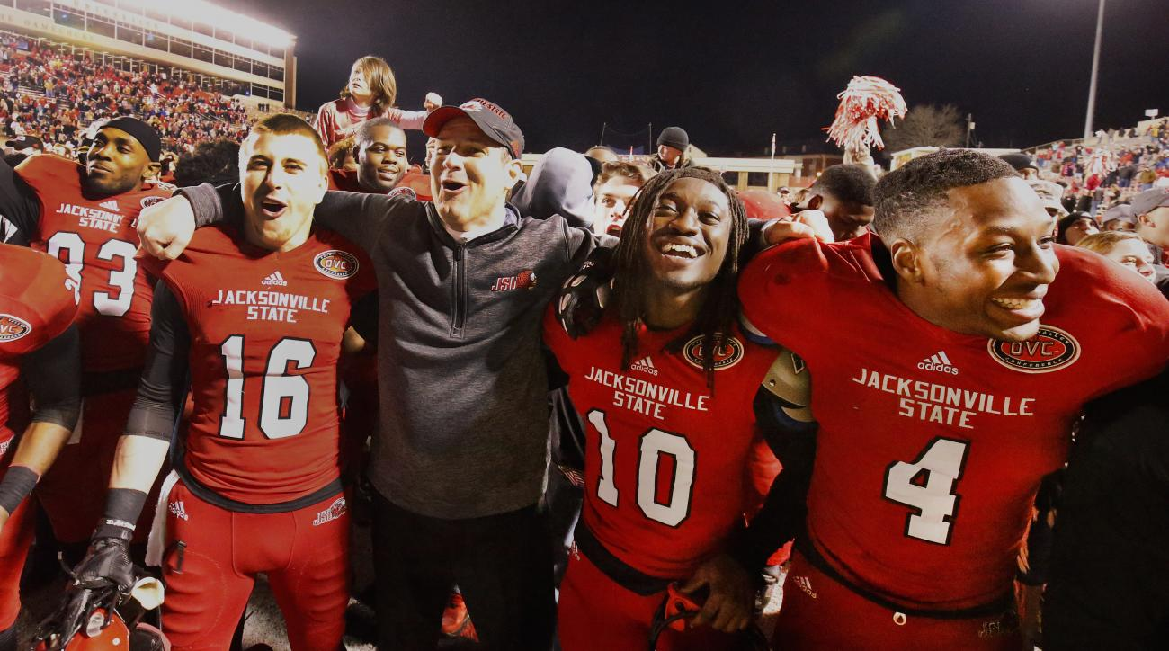 Jacksonville State head coach John Grass with his Gamecocks during celebration after the JSU NCAA semi-final FCS win over Sam Houston State 62-10.