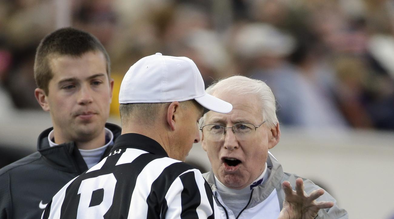 Kansas State head coach Bill Snyder, right, argues with referee Ron Snodgrass in the first half of the Liberty Bowl NCAA college football game between Kansas State and Arkansas Saturday, Jan. 2, 2016, in Memphis, Tenn. (AP Photo/Mark Humphrey)