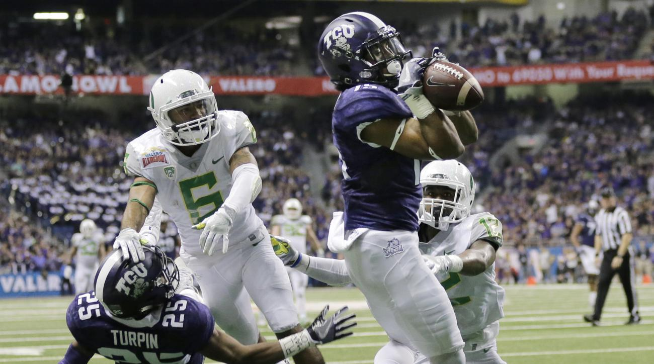 TCU wide receiver Jaelan Austin (15) catches a touchdown pass in front of Oregon cornerback Chris Seisay (12) during the second half of the Alamo Bowl NCAA college football game, Saturday, Jan. 2, 2016, in San Antonio. (AP Photo/Austin Gay)