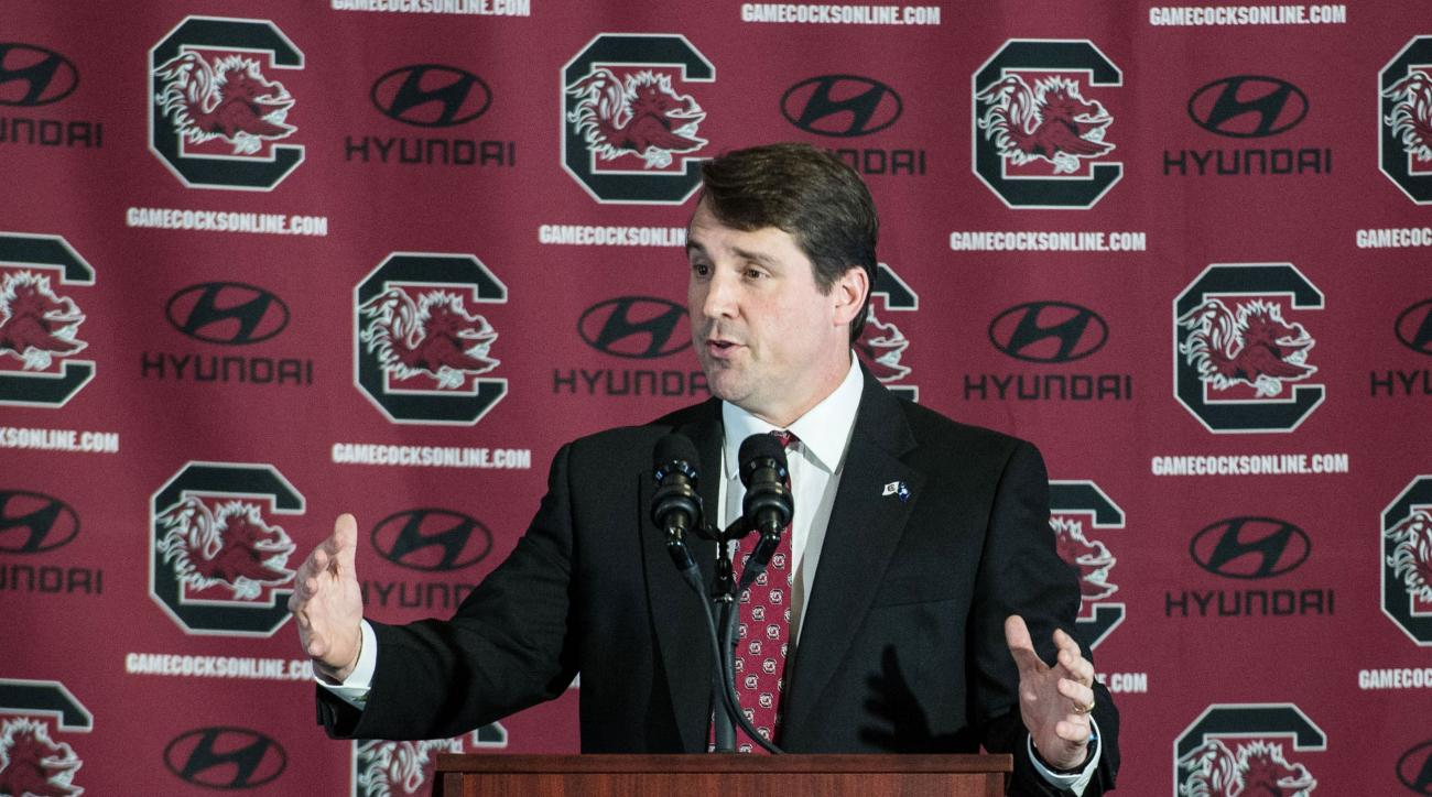 FILE - In this Dec. 7, 2015, file photo, South Carolina NCAA college head football coach Will Muschamp talks to the media at Williams Brice Stadium, in Columbia, S.C. t's been a busy first month for new South Carolina coach Will Muschamp between assemblin
