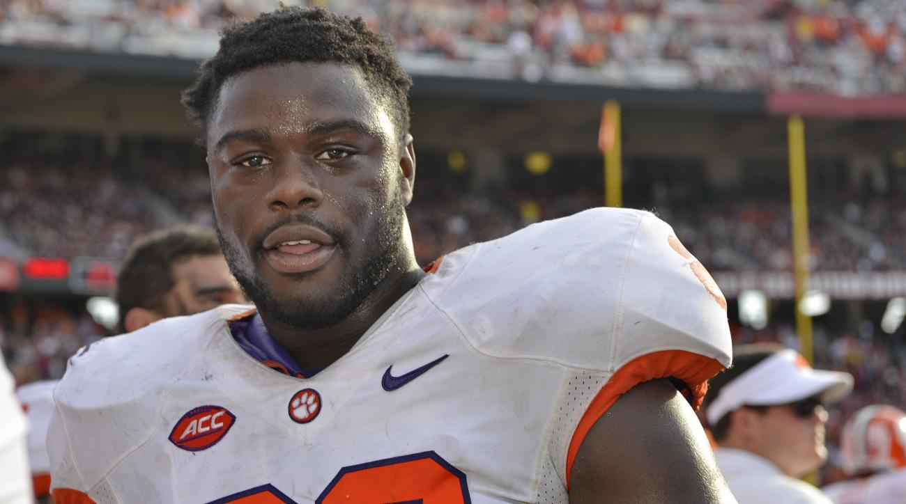 """FILE - In this Nov. 28, 2015, file photo, Clemson's Shaq Lawson looks on from the sideline during the second half of an NCAA college football game against South Carolina, in Columbia, S.C. Clemson coach Dabo Swinney says he is """"very optimistic"""" All-Americ"""