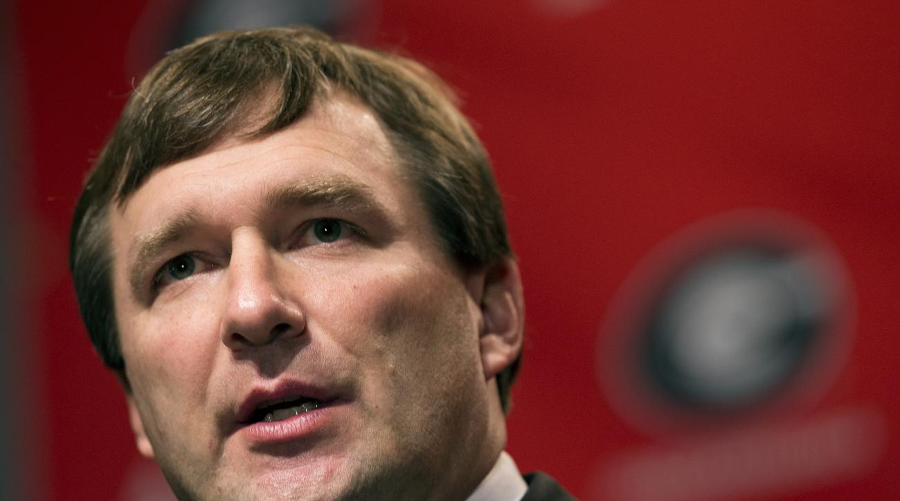 File- This Dec. 7, 2015, file photo shows Alabama defensive coordinator Kirby Smart listens to a question from a reporter during a press conference where he was introduced as Georgia's new head football coach  in Athens, Ga. Smart, who replaced Richt on D