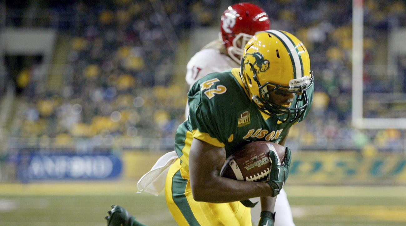 FILE - In this Oct. 17, 2015,  file photo, North Dakota State's Bruce Anderson scores a touchdown against South Dakota during an NCAA college football game in Fargo, N.D. Anderson, a kickoff return man, will be one of three key special teams players when