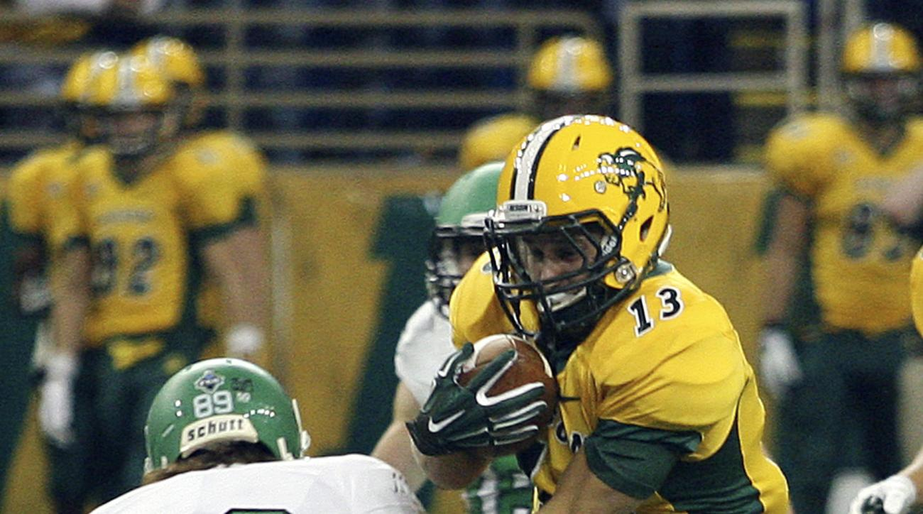 FILE - In this Sept. 19, 2015,  file photo, North Dakota State's Eric Perkins, right, eludes North Dakota defender Mitch Meindel, (89) during an NCAA college football game in Fargo, N.D. Perkins, a punt returner, will be one of three key special teams pla