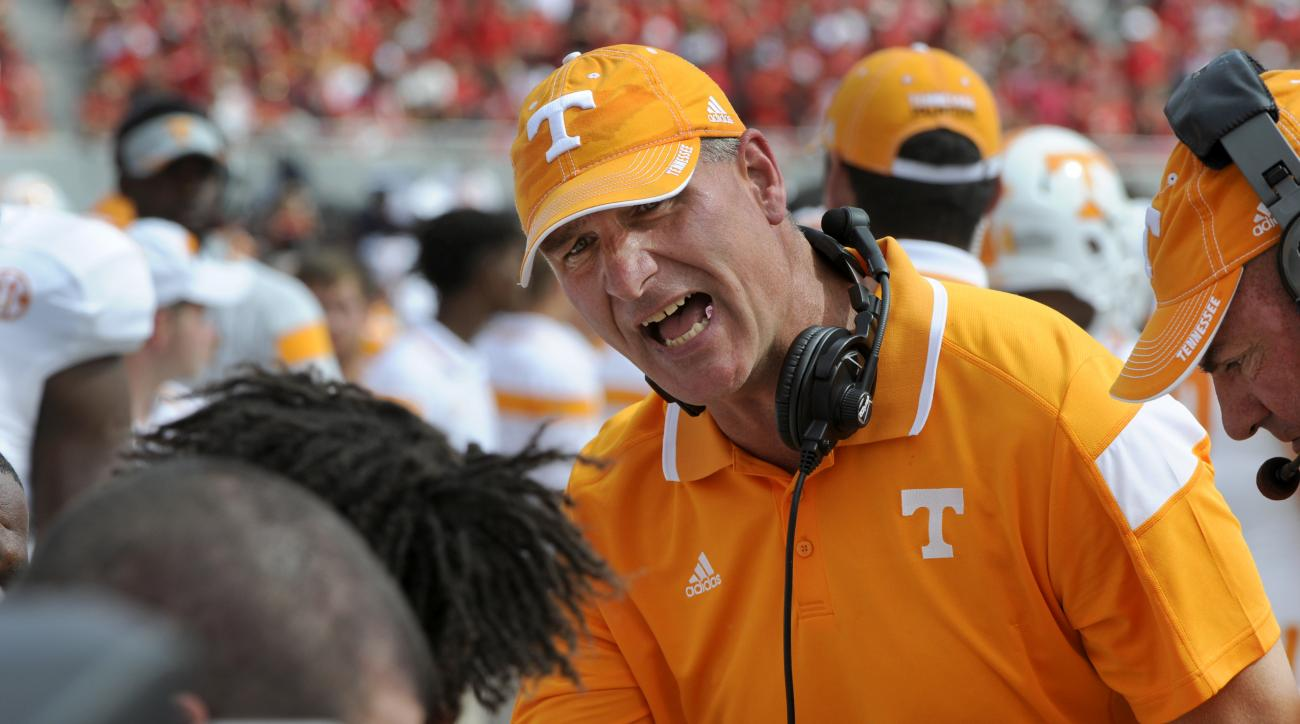 "FILE - In this Saturday, Sep. 27, 2014 file photo, Tennessee defensive coordinator John Jancek talks to players during a NCAA game with Georgia in Athens, Ga. Tennessee announced Wednesday, Jan. 6, 2016 that coach Butch Jones and Jancek ""mutually agreed t"
