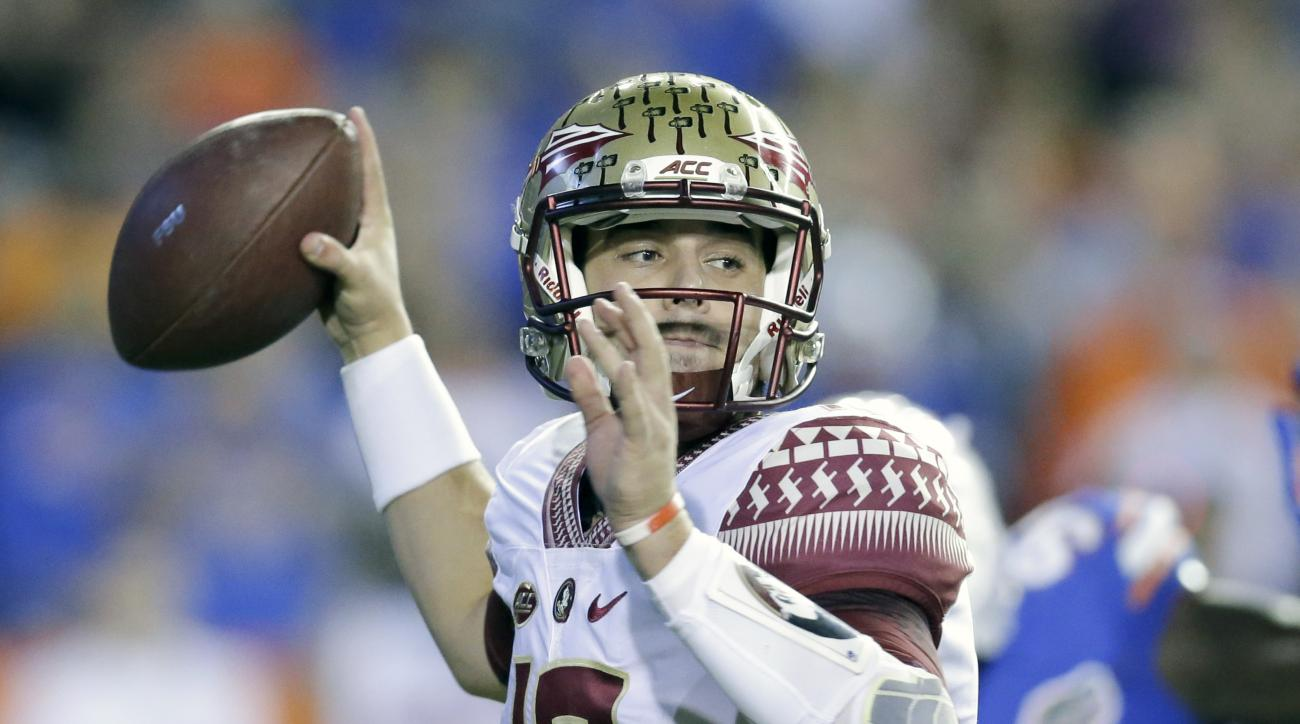 Florida State quarterback Sean Maguire throws a pass against Florida during the first half of an NCAA college football game, Saturday, Nov. 28, 2015, in Gainesville, Fla. (AP Photo/John Raoux)