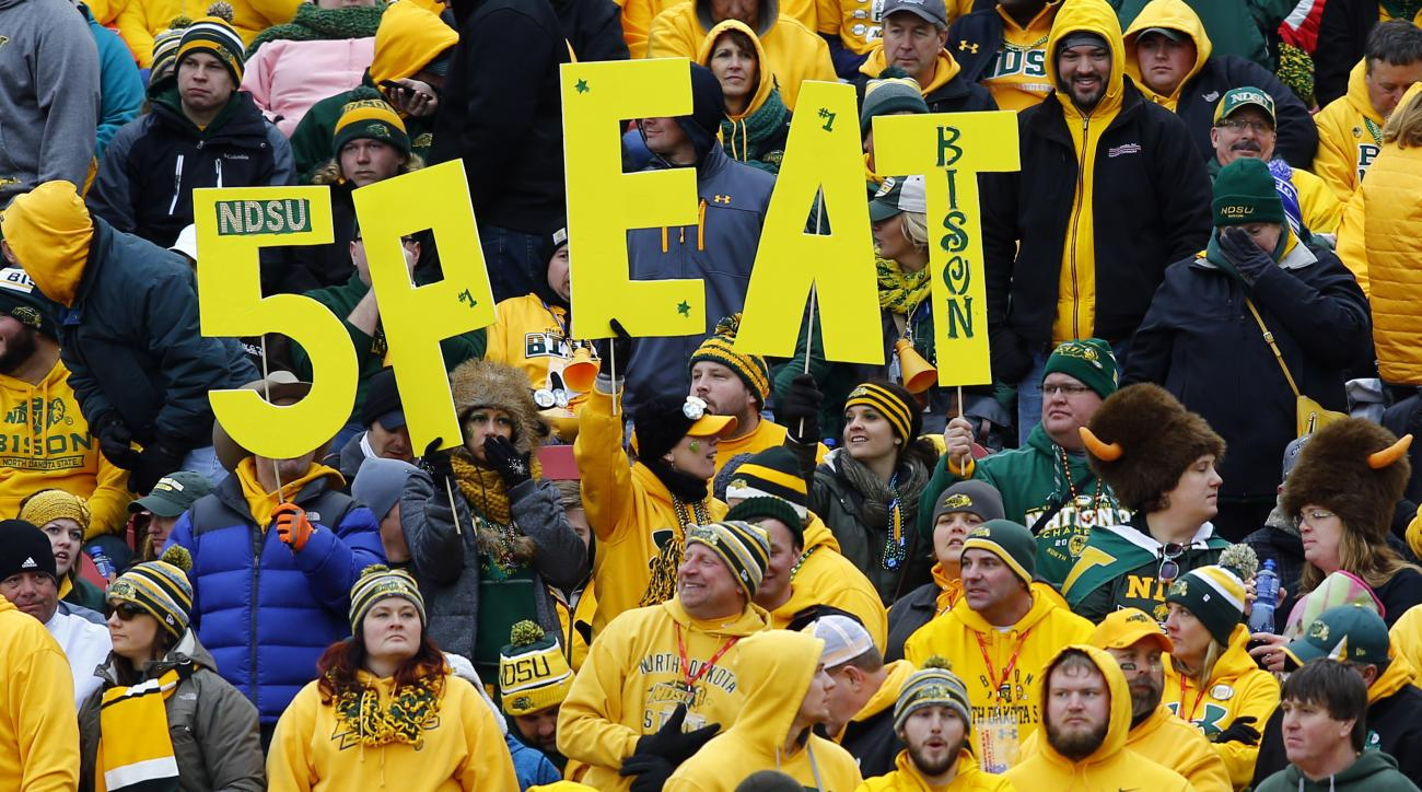 North Dakota State fans celebrate during the FCS championship NCAA college football game against Jacksonville State, Saturday, Jan. 9, 2016, in Frisco, Texas.   North Dakota State won 37-10 for an unprecedented fifth straight FCS championship   (AP Photo/
