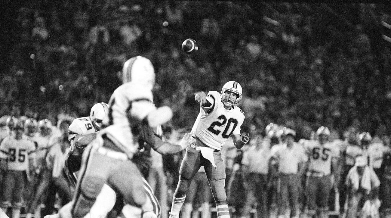 FILE - In this Jan. 2, 1984 file photo, University of Miami quarterback Bernie Kosar (20) throws a pass to fullback Alonzo Highsmith (30) during the third quarter of the Orange Bowl game against Nebraska in Miami. Nebraska came to the game as the 17-point