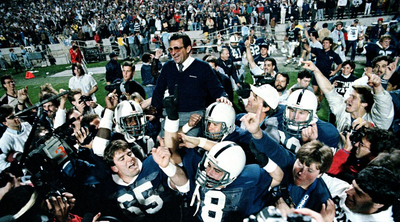FILE - In this Jan. 2, 1987, file photo, Penn State coach Joe Paterno is carried off after they defeated Miami 14-10 in the Fiesta Bowl NCAA college football game in Tempe, Ariz., to win the national championship. Paterno's Nittany Lions upset Jimmy Johns