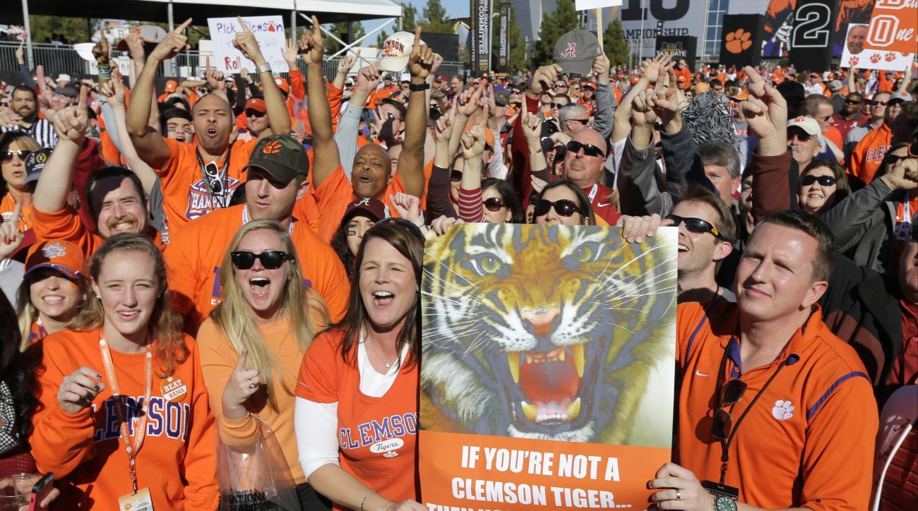 Clemson fans rally outside University of Phoenix Stadium before the NCAA college football playoff championship game against Alabama Monday, Jan. 11, 2016, in Glendale, Ariz. (AP Photo/David J. Phillip)