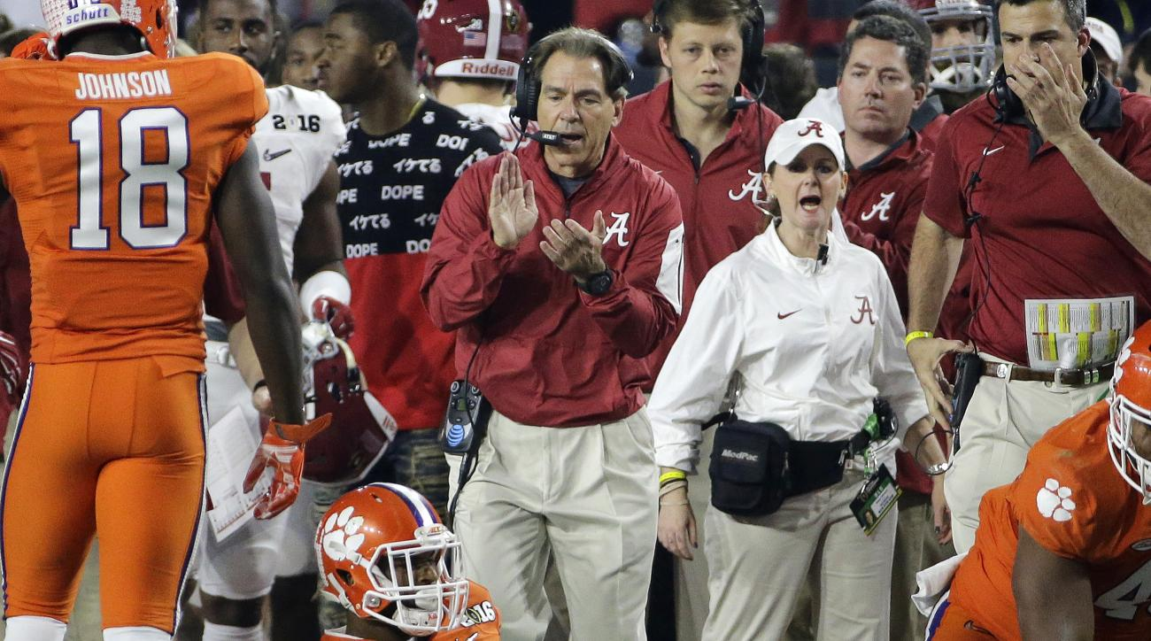 Alabama head coach Nick Saban claps after a punt return during the first half of the NCAA college football playoff championship game against Clemson Monday, Jan. 11, 2016, in Glendale, Ariz. (AP Photo/David J. Phillip)