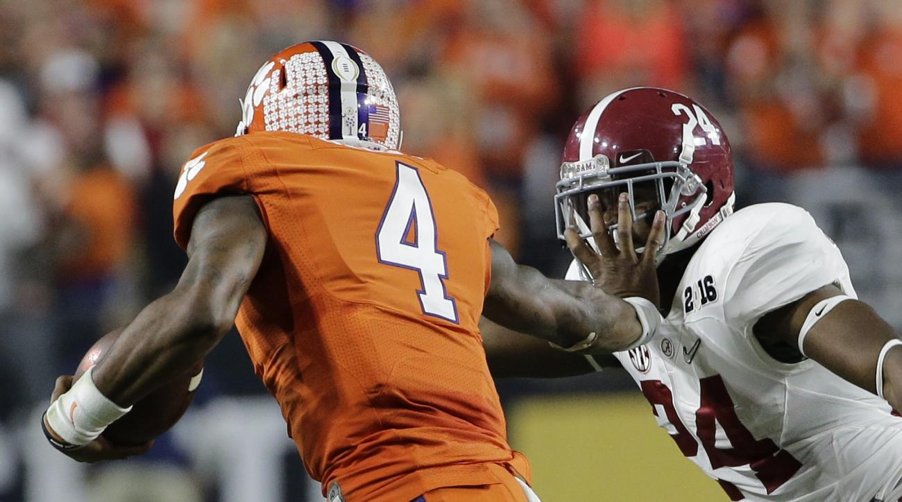 Clemson's Deshaun Watson (4) tries to run past Alabama's Geno Matias-Smith during the first half of the NCAA college football playoff championship game Monday, Jan. 11, 2016, in Glendale, Ariz. (AP Photo/David J. Phillip)