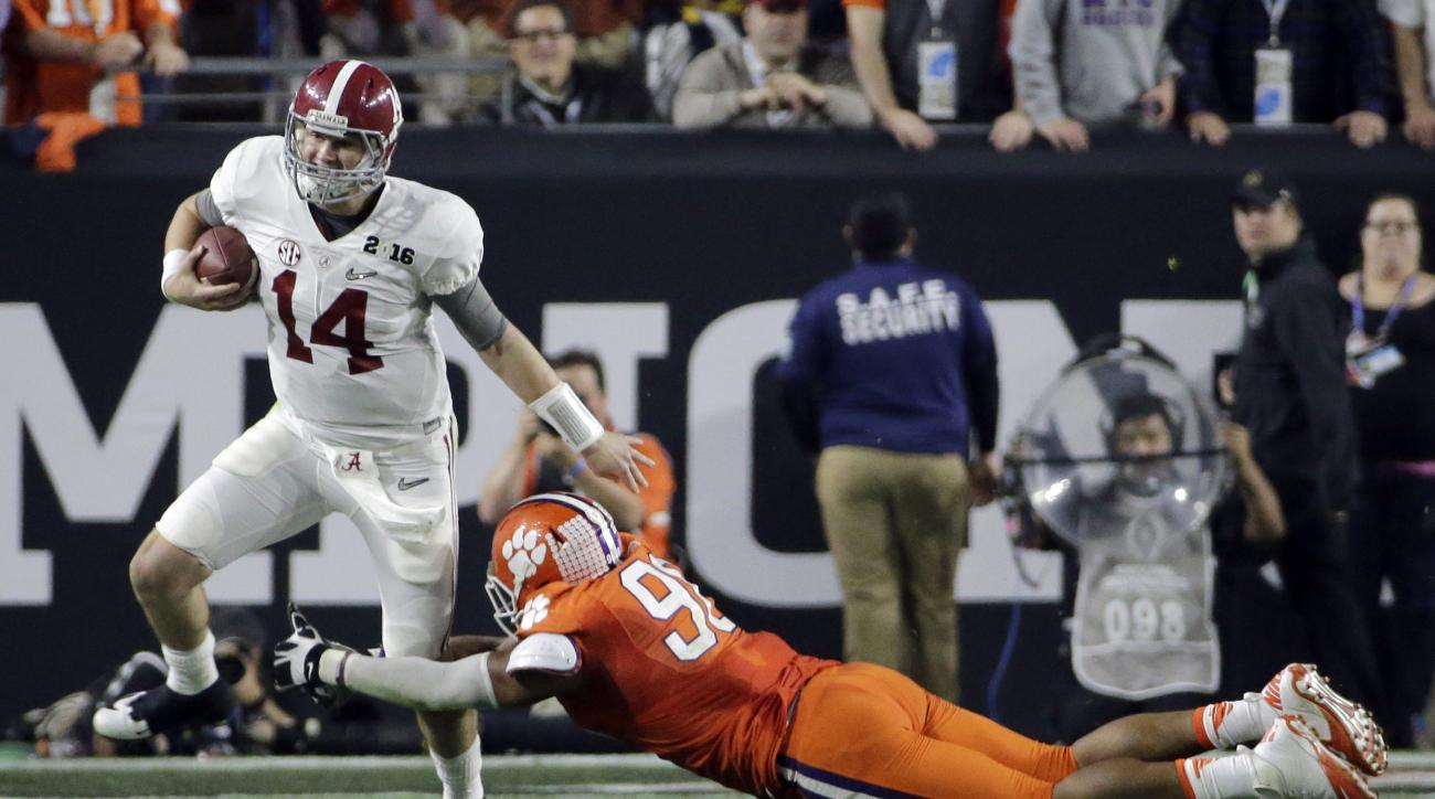 Alabama's Jake Coker (14) gets away from Clemson's Kevin Dodd during the first half of the NCAA college football playoff championship game Monday, Jan. 11, 2016, in Glendale, Ariz. (AP Photo/David J. Phillip)