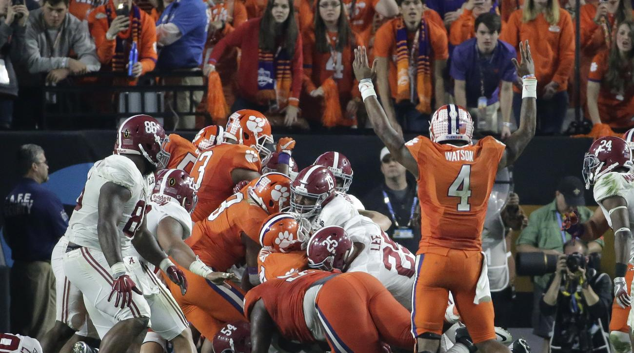 Clemson's Deshaun Watson (4) celebrates a touchdown during the second half of the NCAA college football playoff championship game against Alabama Monday, Jan. 11, 2016, in Glendale, Ariz. (AP Photo/Chris Carlson)