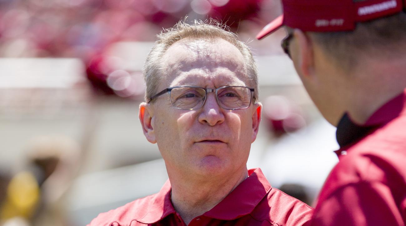 Arkansas athletic director Jeff Long stands on the sidelines before their spring NCAA college football game, Saturday, April 25, 2015, in Fayetteville, Ark. (AP Photo/Gareth Patterson)