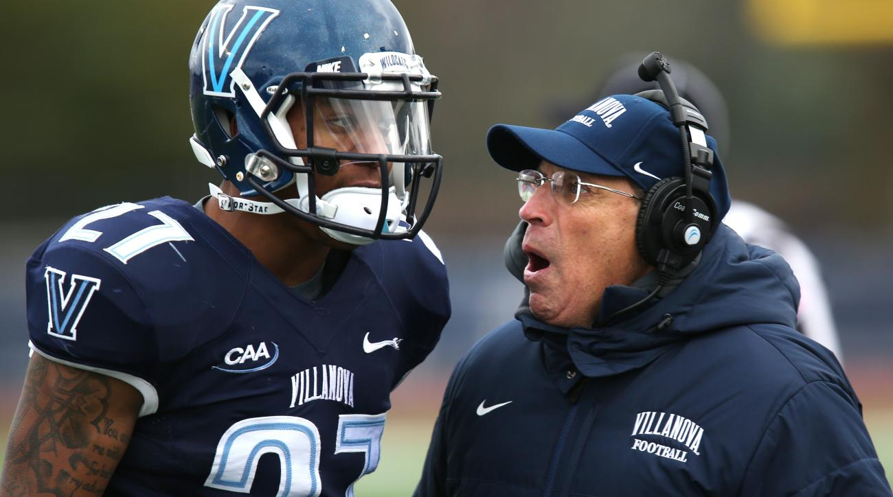 Villanova coach Andy Talley confers with defensive back Malik Reaves (27) in the first half of an FCS quarterfinal NCAA college football game against Sam Houston State, Saturday, Dec. 13, 2014, in Villanova. Sam Houston State won 34-31. (AP Photo/Laurence
