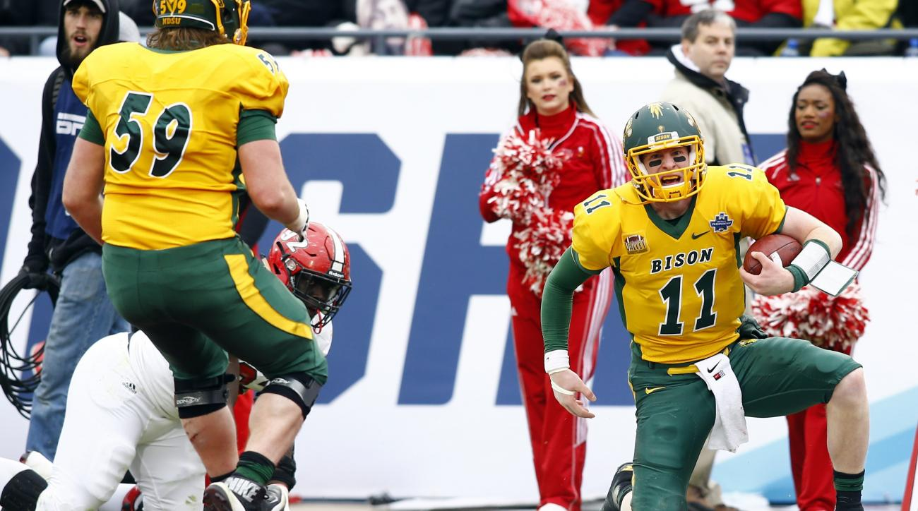 North Dakota State quarterback Carson Wentz (11) reacts after scoring a touchdown as tackle Joe Haeg (59) watches during the first half of the FCS championship NCAA college football game against Jacksonville State, Saturday, Jan. 9, 2016, in Frisco, Texas