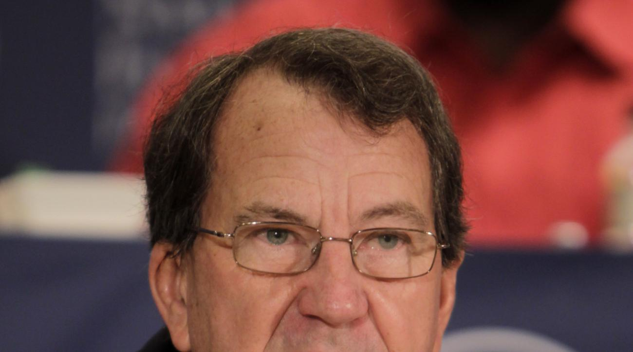 Former University of Michigan football coach Lloyd Carr speaks during a news conference in New York, Tuesday, Dec. 6, 2011. Carr was one of two coaches and 14 players in the 2011 College Football Hall of Fame class. (AP Photo/Seth Wenig)