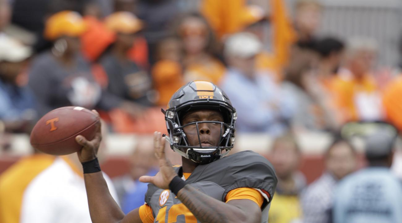 Tennessee quarterback Sheriron Jones (13) throws before the start of an NCAA college football game between Tennessee and Georgia Saturday, Oct. 10, 2015 in Knoxville, Tenn. (AP Photo/Wade Payne)
