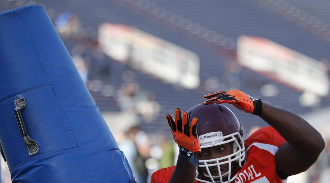 Eastern Kentucky defensive end Noah Spence runs through drills during NCAA college football practice for the Senior Bowl, Thursday, Jan. 28, 2016, at LaddPeebles Stadium, in Mobile, Ala. (AP Photo/Brynn Anderson)