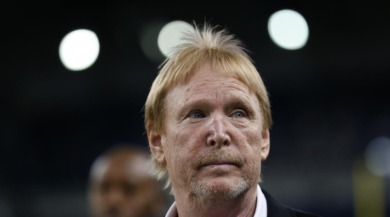 Oakland Raiders team owner Mark Davis walks on the field before an NFL football game against the Detroit Lions, Sunday, Nov. 22, 2015, in Detroit. (AP Photo/Paul Sancya)