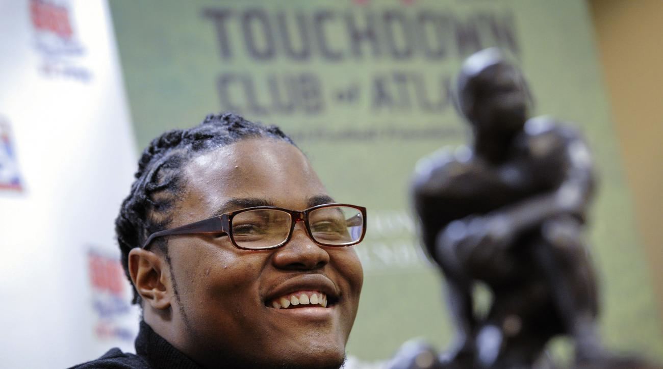 FILE - In this Thursday, Jan. 28, 2016, file photo, Rashan Gary, of Paramus, N.J., talks to members of the media in Atlanta, while on hand to receive the Bobby Dodd national high school lineman of the year award at the Touchdown Club of Atlanta. The defen