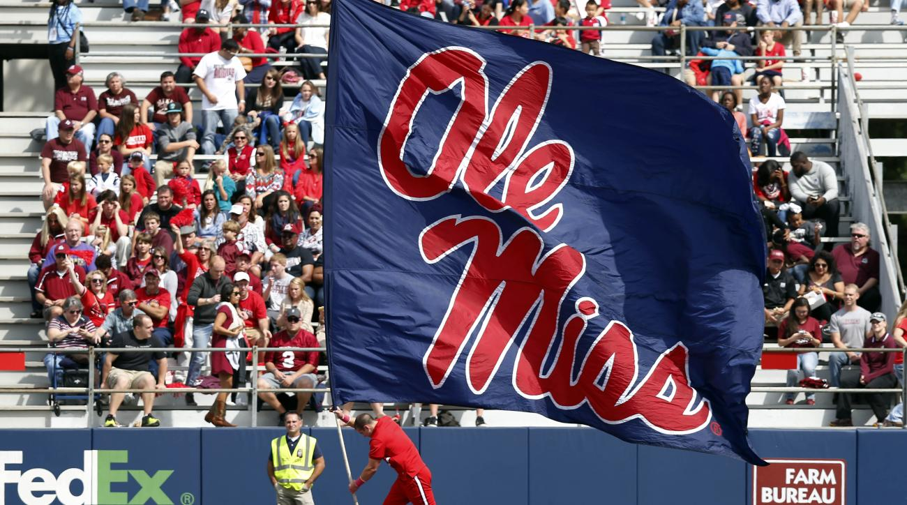 A Mississippi cheerleader runs along the end zone with an oversized Ole Miss flag following a score in the second half of an NCAA college football game in Oxford, Miss., Saturday, Oct. 10, 2015. No. 14 Mississippi won 52-3. (AP Photo/Rogelio V. Solis)