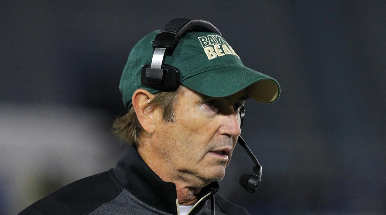 FILE - In this Sept. 12, 2014, file photo, Baylor coach Art Briles walks the sideline during his team's NCAA college football game against Buffalo in Amherst, N.Y. Baylor University will conduct an investigation into the school's handling of sexual assaul