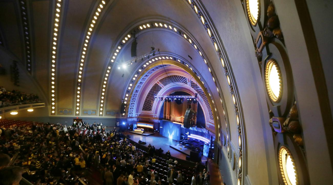 Football fans wait in Hill Auditorium at the University of Michigan for the Signing With the Stars spectacle, Wednesday, Feb. 3, 2016 in Ann Arbor, Mich. Michigan coach Jim Harbaugh with Tom Brady, Derek Jeter and even Ric Flair are expected to be on hand