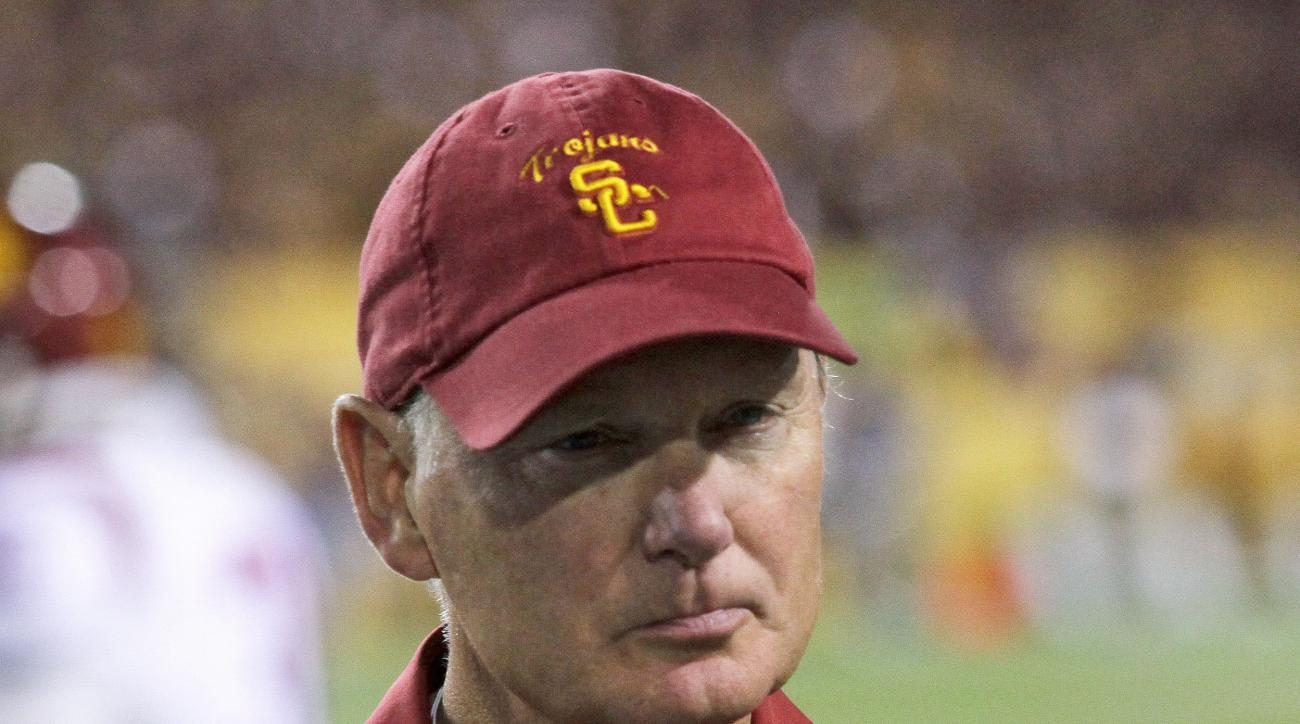 FILE - In this Sept. 28, 2013, file photo, Southern California athletic director Pat Haden stands on the field after USC lost to Arizona State in an NCAA college football game in Tempe, Ariz. Haden says he will retire on June 30, 2016. USC President Max N