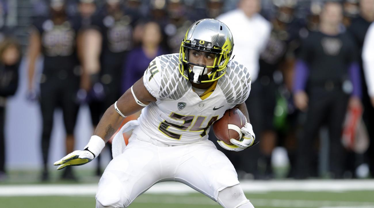 FILE - In this Oct. 12, 2013, file photo, Oregon's Thomas Tyner carries against Washington during an NCAA college football game in Seattle. Tyner has decided to take a medical retirement after sitting out all of last season because of a shoulder injury. T