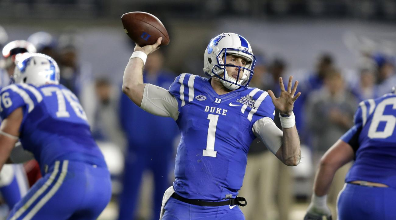 Duke quarterback Thomas Sirk looks to throw during the first half of the Pinstripe Bowl NCAA college football game against Indiana at Yankee Stadium in New York, Saturday, Dec. 26, 2015. (AP Photo/Seth Wenig)