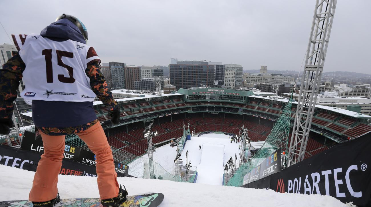 Snowboarder Katie Ormerod, of Britain, prepares to make a practice jump, Wednesday, Feb. 10, 2016, in advance of the Big Air at Fenway skiing and snowboarding U.S. Grand Prix tour event at Fenway Park in Boston. The competition is to be held Thursday and