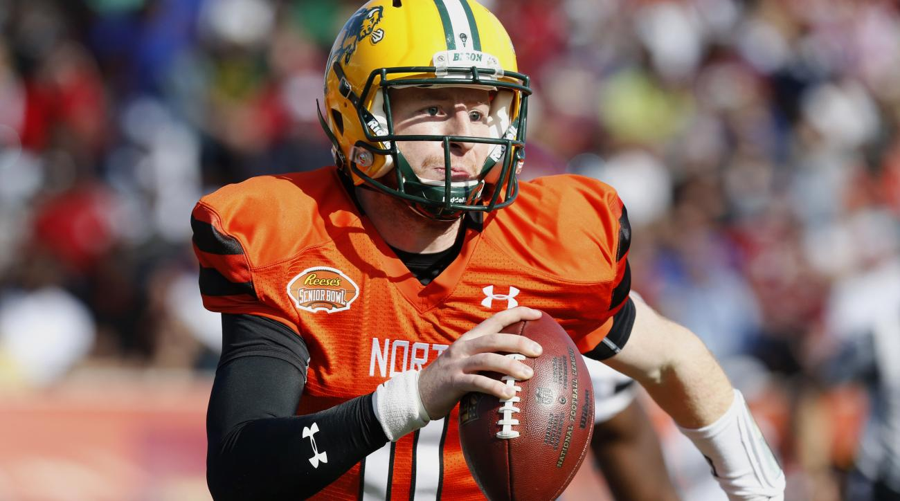 FILE - In this Jan. 30, 2016, file photo, North squad quarterback Carson Wentz of North Dakota State (11) scrambles with the ball during the Senior Bowl NCAA college football game at LaddPeebles Stadium in Mobile, Ala. North Dakota State football coaches