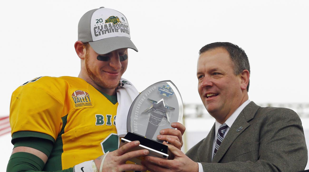 FILE - In this Jan. 9, 201, 6 file photo, North Dakota State quarterback Carson Wentz accepts the trophy for the most valuable player after NDSU beat Jacksonville State 37-10 in the FCS championship NCAA college football game in Frisco, Texas. North Dakot