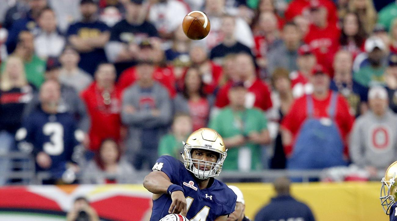Notre Dame quarterback DeShone Kizer (14) throws a pass Ohio State defensive lineman Joey Bosa (97) leans in for a hit during the first half of the Fiesta Bowl NCAA College football game, Friday, Jan. 1, 2016, in Glendale, Ariz. Bosa was called for target